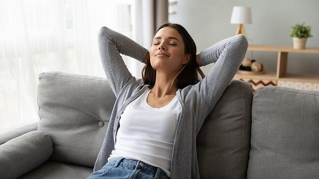 Woman relax in sofa_15%